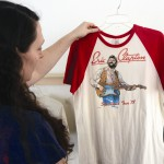 Well worn vintage band T-shirts and a variety of records are included in the exhibit.