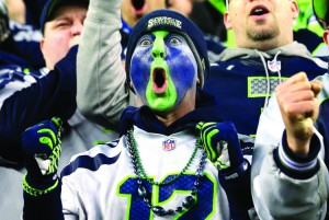 A Seattle Seahawks fan cheers during  Saturday's divisional playoff football game between the Seahawks and the Carolina Panthers in Seattle. The Seahawks won 31-17.