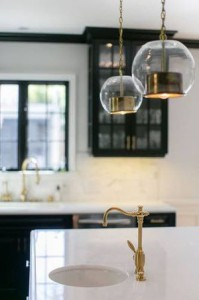 Bright gold fixtures shown in a redesigned kitchen.