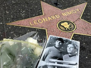 """Flowers adorn the Hollywood Walk of Fame star of Leonard Nimoy in Los Angeles Friday, Feb. 27, 2015. Nimoy, famous for playing officer Mr. Spock in """"Star Trek"""" died Friday, Feb. 27, 2015 in Los Angeles of end-stage chronic obstructive pulmonary disease. He was 83. (AP Photo/Damian Dovarganes)"""