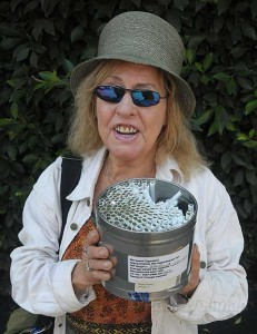 Elvy Musikka holds a tin full of marijuana joints she receives from the U.S. government through its medical marijuana program.