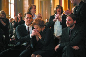 "Randy (Ryan Reynolds) comforts Maria (Helen Mirren) in after a court hearing ""Woman in Gold."""