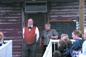 Dan Leonard and Kathy Meyer portray school teachers in a class about education in 1895.