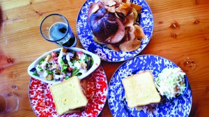 Hardwood smoked meat is a key ingredient in many dishes at Drover's Run, including sandwiches.