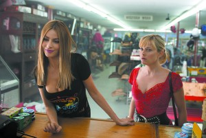 "In this image released by Warner Bros. Pictures, Reese Witherspoon, right, and Sofia Vergara appear in a scene from ""Hot Pursuit."" (Sam Emerson/Warner Bros. Pictures via AP)"