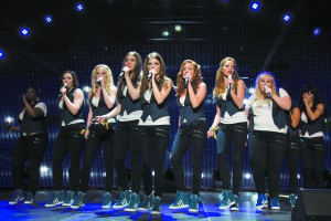 """This photo released by Universal Pictures shows, from left, Ester Dean as Cynthia Rose, Shelley Regner as Ashley, Kelley Alice Jakle as Jessica, Hailee Steinfeld as Emily, Anna Kendrick as Beca, Brittany Snow as Chloe, Alexis Knapp as Stacie, Rebel Wilson as Fat Amy, and Hana Mae Lee as Lilly Anna Kendrick as Beca, as the Barden Bellas in a scene from the film, """"Pitch Perfect 2."""" (Richard Cartwright/Universal Pictures via AP)"""
