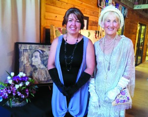 Carrie Vielle (left), the resident artist who emceed the 2014  annual fundraising tea for Artisans at the Dahmen Barn, and the 2014 costume contest winner, Mary Ann Boehmke.