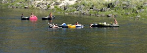 The cool Clearwater River provides a relief from the sweltering heat as a group of people float near Orofino.