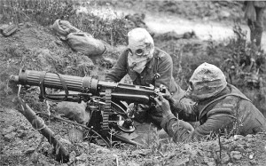 A British Vickers machine gun crew wearing PH-type anti-gas helmets. Near Ovillers during the Battle of the Somme, July 1916.