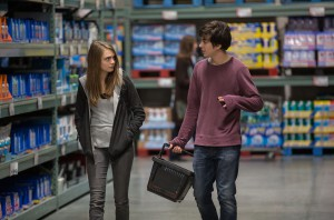 """This photo provided by Twentieth Century Fox shows Cara Delevingne, left, as Margo, and Nat Wolff as Quentin, in a scene from the film, """"Paper Towns.""""  (Michael Tackett/Twentieth Century Fox via AP)"""