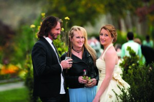 """This photo provided by courtesy of Sony Pictures shows, Rick Springfield, from left, as Greg, Meryl Streep, as Ricki, and Mamie Gummer as Julie, in TriStar Pictures' """"Ricki and the Flash."""" The movie opens in U.S. theaters on Friday, Aug. 7, 2015. (Bob Vergara/Sony Pictures via AP)"""