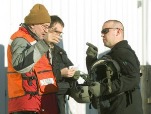 Marvin Pillers, left, talks with helicopter crewman  during a search for University of Idaho student Joseph Wiederrick.