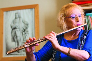 Pullman flutist Ann Yasinitsky plays during a rehearsal.
