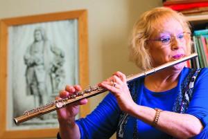 Pullman flutist Ann Yasinitsky plays during a rehearsal.