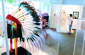 An eagle feather headdress made by Nakia Williamson Cloud, along with ornate beadwork and regalia are on display at the Center for Arts and History.
