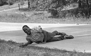 Civil rights activist James Meredith grimaces in pain as he pulls himself across Highway 51 after being shot in Hernando, Miss., June 6, 1966. Meredith was on a March Against Fear to encourage black Americans to register to vote when he was shot. He completed the march from Memphis, Tenn., to Jackson, Miss., after treatment of his wounds. (AP Photo/Jack Thornell)