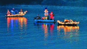 A flotilla of boats circle on the Snake River before the annual Hells Canyon Boat Club lighted boat parade in 2012.