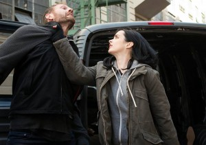 """Jessica Jones (Krysten Ritter) uses her super strength to help her as a Private Investigator in the new Netflix show """"Jessica Jones."""""""