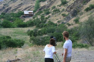 A film crew shoots footage at the McGreer's Hells Canyon cabin which was the setting for a reality TV show on off-the-grid living.