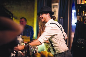Co-owner Cory Preston tends bar during a Prohibition Repeal party Dec. 5 2015, at Etsi Bravo in Pullman.