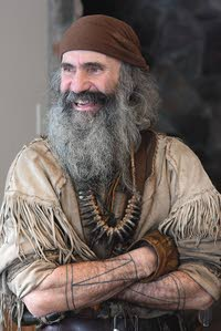 Bear Claw's cheerful smile cuts through his gruff mountain man look. (photo Steve Hanks, Lewiston Tribune)