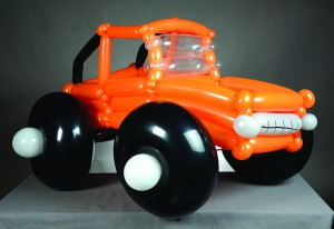 This monster truck is a wearable creation that can slip over a child's shoulders.