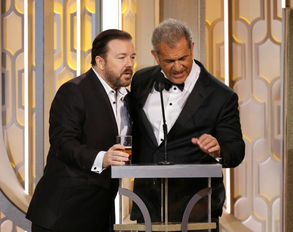 In this image released by NBC, host Ricky Gervais, left, and Mel Gibson appear on stage at the 73rd Annual Golden Globe Awards at the Beverly Hilton Hotel in Beverly Hills, Calif., on Sunday, Jan. 10, 2016. (Paul Drinkwater/NBC via AP)