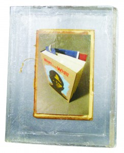 """""""The One I Will Never Finish Nor Open Again"""" by Jacinda Russell of Muncie, Ind. Medium: Resin, archival inkjet print, found book. Artist Statement: """"The bookmark in Dave Eggers' 'What is the What' is evidence of a catastrophic event that changed the course of my life. As much as I enjoyed reading it, I was never able to finish, let alone open it again. Sometimes when dusting the cover on the shelf, the bookmark's presence reminds me of a fossil frozen in geological strata. It is an interruption indicating an occurrence I would rather forget but choose to remember for reasons not yet known."""""""