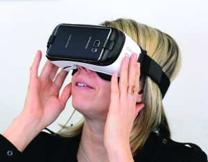 A woman tries the Samsung Gear VR, one of many virtual reality headsets now on the market for consumers.