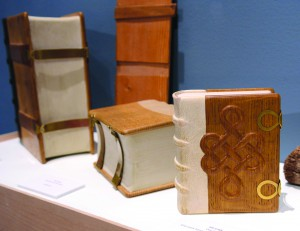Hand made books by Jim Croft include one with Knot work hand carved by a pocket knife.