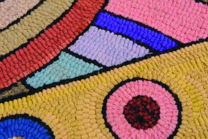 "Elieen Brayton's hooked rug work includes one titled ""Ground Rainbow"" that is made of wool and burlap."