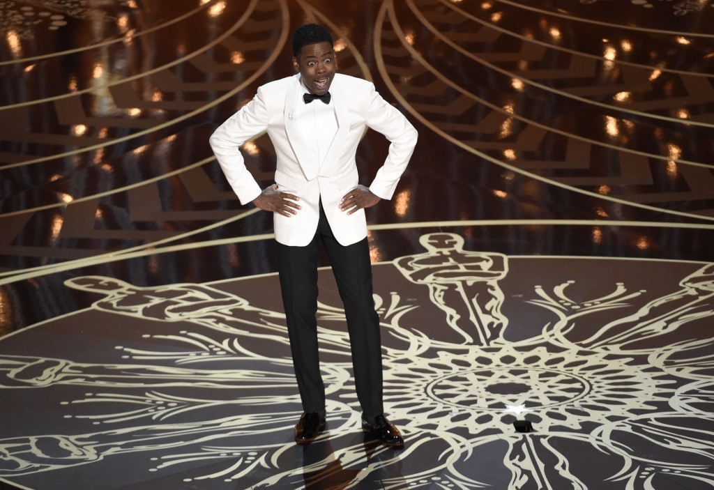 Host Chris Rock speaks at the Oscars on Sunday at the Dolby Theatre in Los Angeles. (Photo by Chris Pizzello/Invision/AP)