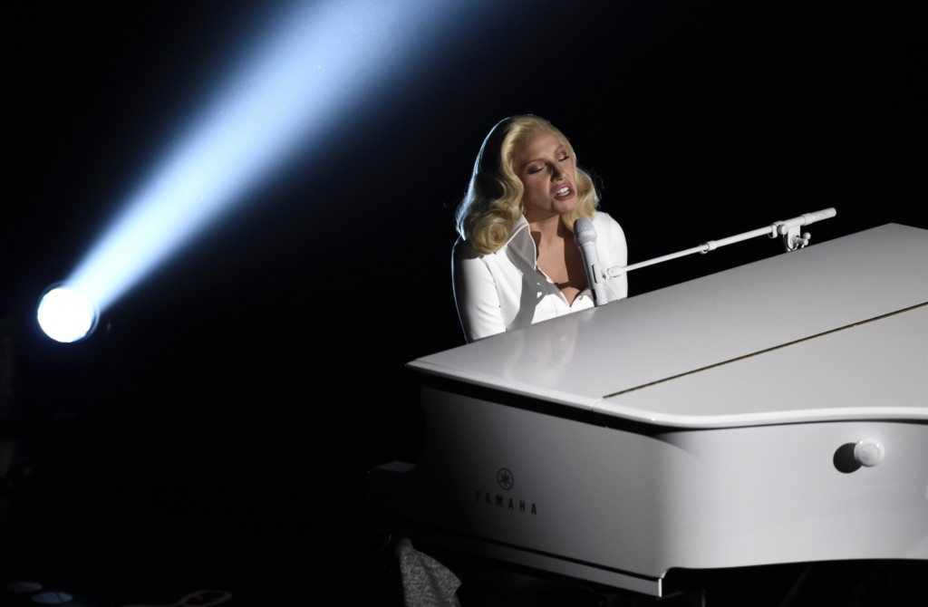 """Lady Gaga performs """"Til It Happens To You"""" that is nominated for best original song from """"The Hunting Ground"""" at the Oscars on Sunday, at the Dolby Theatre in Los Angeles. (Photo by Chris Pizzello/Invision/AP)"""