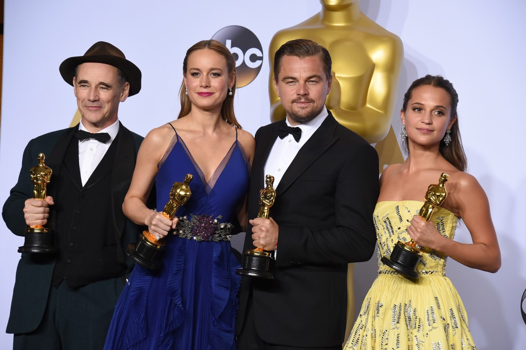 "Mark Rylance, winner of the award for best actor in a supporting role for ""Bridge of Spies,"" from left, Brie Larson, winner of the award for best actress in a leading role for ""Room"", Leonardo DiCaprio, winner of the award for best actor in a leading role for ""The Revenant"", and Alicia Vikander, winner of the award for best actress in a supporting role for ""The Danish Girl"" pose in the press room at the Oscars on Sunday, Feb. 28, 2016, at the Dolby Theatre in Los Angeles. (Photo by Jordan Strauss/Invision/AP)"