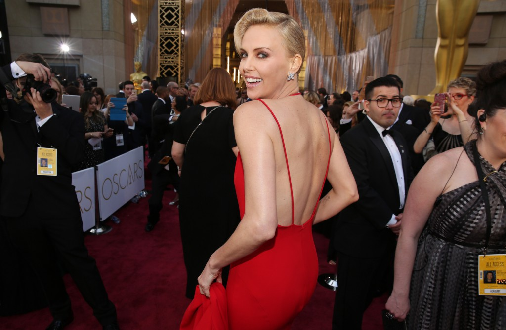 Charlize Theron arrives at the Oscars on Sunday, at the Dolby Theatre in Los Angeles. (Photo by Matt Sayles/Invision/AP)