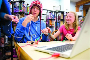 Travis and Riley Carter use a Makey Makey, which is one of the devices that can be checked out in make kits, at the Moscow Public Library on Friday.