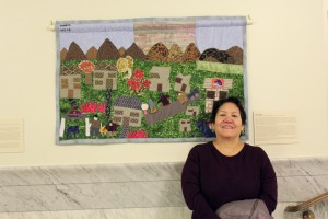 Maria Shefa in front of her story quilt when it was in exhibit at the Idaho Capitol