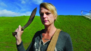 "Stacey Osorio weilds her khukuri , the only item she brought with her for her appearance on ""Naked and Afraid."""