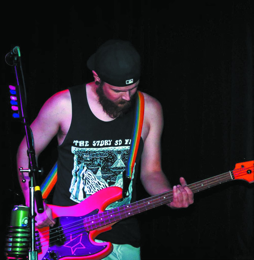 When he's not playing bass guitar for the band Rise & Shine, Chris Bennett interviews local musicians for his podcast Tales from the Bass. (Photo by Kelli Danner)