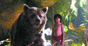 """In this image released by Disney, Mowgli, portrayed by Neel Sethi, right, and Baloo the bear, voiced by Bill Murray, appear in a scene from, """"The Jungle Book."""" (Disney via AP)"""