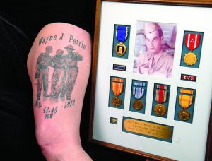 Jody Colegrove had a tatoo of her father who survived the Bataan Death March during WWII put on her thigh.