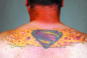 Chris Currin of Lewiston got his tattoo after surviving a neck aneurysm.