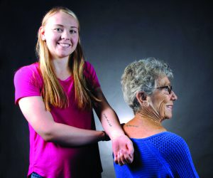 Katie Babino and her grandmother, Nancy Poole share a tattoo of a meaningful song. (Steve Hanks photo)