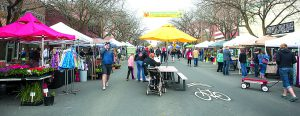 Vendor booths line Main Street as patrons shop during the first Moscow Farmer's Market of 2014 on Saturday, May 3.