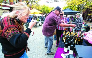 Jan Kirchhoff, left, of Moscow, Roger Vielle, center, and Wendy Wegner sample Camas Prairie Winery wines for sale at the Moscow Farmers Market on Saturday, Oct. 11, 2014.