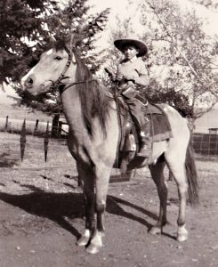 Margaret Nell Waters, at age 6 or 7, setting off school two miles away on her horse.