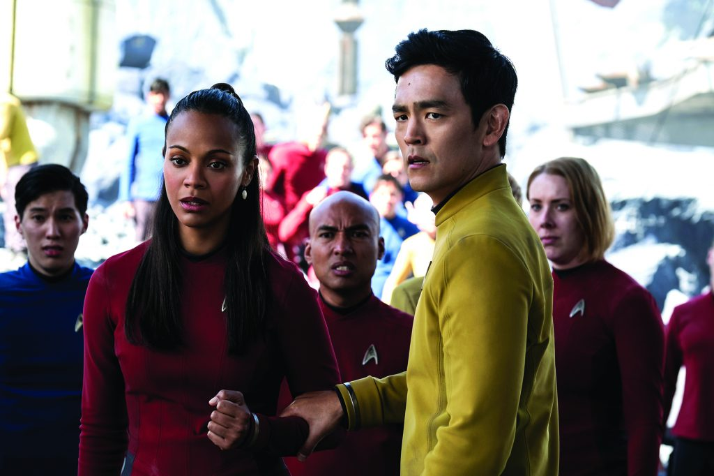 "In this image released by Paramount Pictures, Zoe Saldana, left, as Uhura and John Cho as Sulu appear in a scene from, ""Star Trek Beyond."" (Kimberley French/Paramount Pictures via AP)"