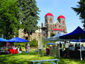 Arts and crafts fair vendors set up at last year's Raspberry Festival on the lawn of the Monastery of St. Gertude at Cottonwood.