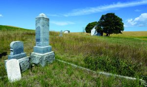 A tiny cemetery behind the church is still the final resting place for several pioneers.