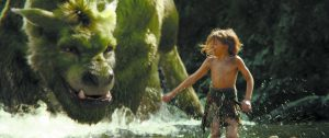"""This image released by Disney shows Oakes Fegley in a scene from """"Pete's Dragon."""" (Disney via AP)"""